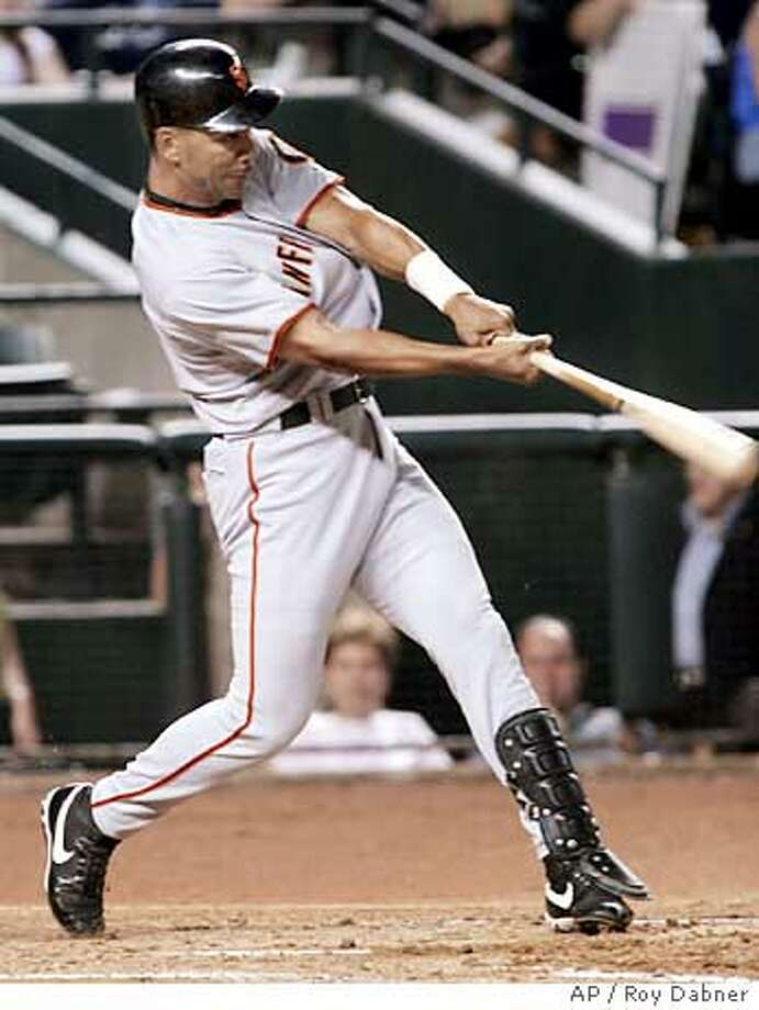 San Francisco Giants Moises Alou hits a single off Arizona Diamondbacks Brandon Webb, driving in Omar Vizquel and J.T. Snow, during the third inning, Wednesday, June 29, 2005, in Phoenix.(AP Photo/Roy Dabner) Photo: ROY DABNER