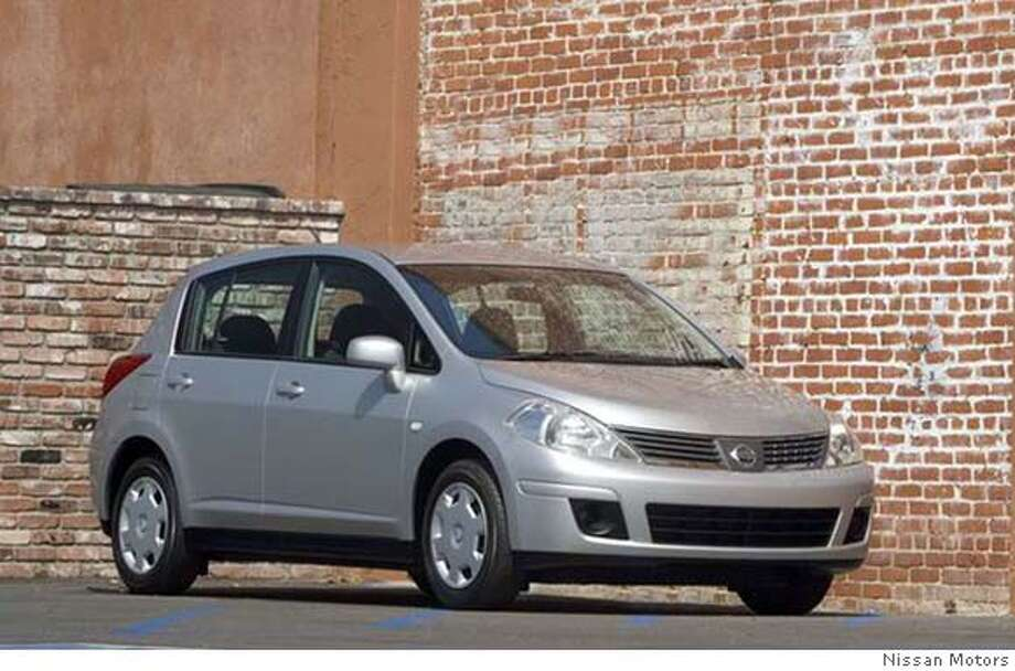 "** FILE **In a photo provided by Nissan Motors, a 2007 Nissan Versa hatchback is shown in an undated photo. Tiny and affordable, subcompact vehicles have come a long way from their ""econobox"" past. The small, entry-level vehicles used to offer few frills and raised concerns over safety. But a combination of factors _ elevated gas prices, a focus on slick designs and technology marketed to young drivers _ have helped give the ""B-cars"" more visibility in the crowded auto marketplace. (AP Photo/Nissan Motors, file)"