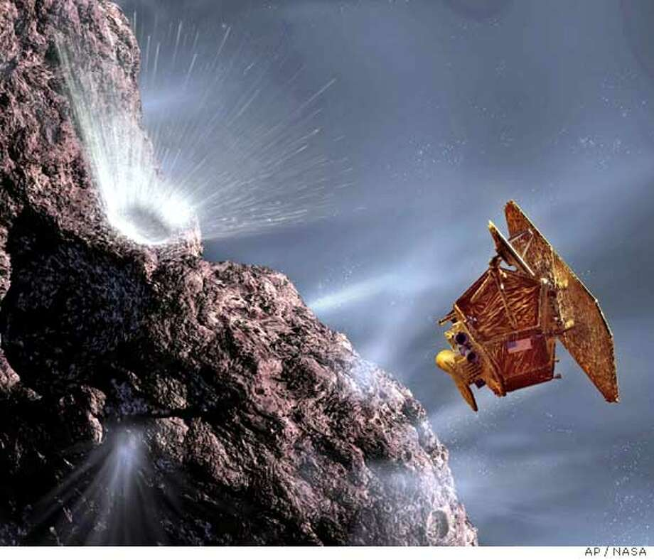 This artist rendition released by NASA shows an explosion, top left, on the Tempel 1 comet after the probe from the Deep Impact spacecraft collided with the comet early Monday, July 4, 2005. The successful strike 83 million miles (133.6 million km) away from Earth marked the first time a spacecraft touched the surface of a comet. (AP Photo/NASA) Ran on: 07-05-2005  An artist's rendition depicts the explosion (top left) on the Tempel 1 comet after the impactor from the Deep Impact spacecraft collided with the comet. Ran on: 07-05-2005  An artist's rendition depicts the explosion (top left) on the Tempel 1 comet after the impactor from the Deep Impact spacecraft collided with the comet.