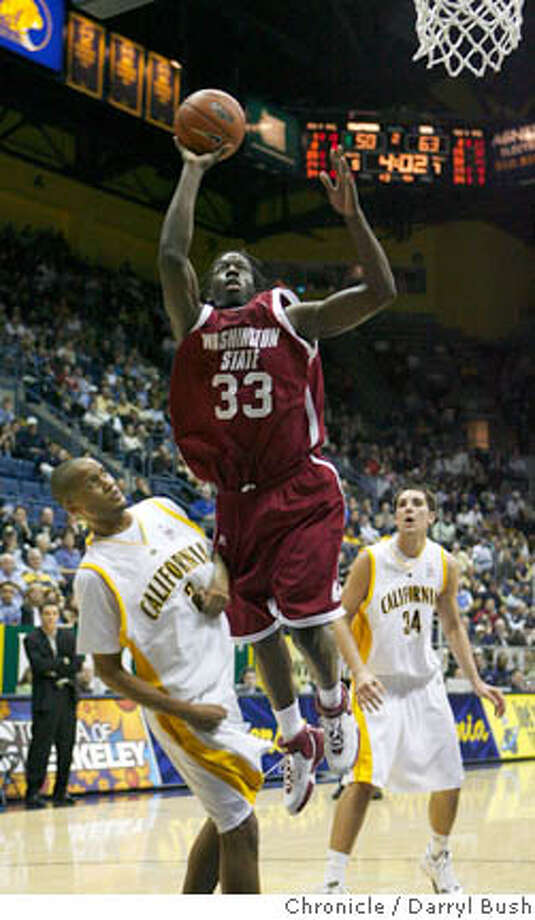 CAL_006_db.JPG  Washington State's Ivory Clark (33) scores past California's Omar Wilkes (2) and Ryan Anderson (34) in 2nd half men's basketball action; Washington State defeated California 73-56 at Haas Pavilion in Berkeley, CA, on Thursday, January, 11, 2007. photo taken: 1/11/07  Darryl Bush / The Chronicle ** roster (cq) Ran on: 01-12-2007  Ivory Clark of Washington State scores past Cal's Omar Wilkes and Ryan Anderson in the second half.  Ran on: 01-12-2007  Ivory Clark of Washington State scores past Cal's Omar Wilkes and Ryan Anderson in the second half. Photo: Darryl Bush