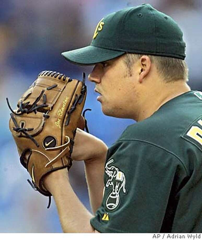 Oakland Athletics' Joe Blanton focuses as he pitches during American League action against the Toronto Blue Jays in Toronto on Wednesday July 6, 2005. (AP PHOTO/Adrian Wyld, CP) Photo: ADRIAN WYLD
