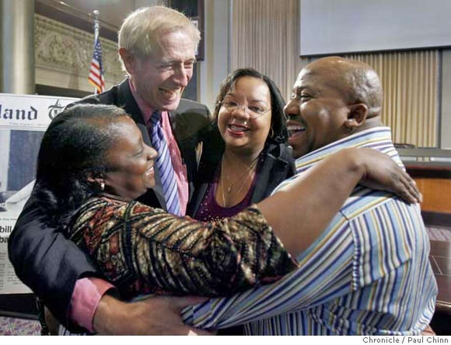 Tay McArthur (second from left) hugs former Oakland Tech High School students Gwendolyn Lovely-Patterson (left), Karen Kennedy-Freeman (center) and Leroy Bradford to celebrate the 25th anniversary of California's Martin Luther King Jr. holiday in Oakland, Calif. on Friday, Jan. 12, 2007. Led by advisor Tay McArthur, the students lobbied the state legislature for enactment of the holiday which was signed into law by then-Governor Jerry Brown. Friday's event was held in Council Chambers at Oakland City Hall.  PAUL CHINN/The Chronicle  **Tay McArthur, Gwendolyn Lovely-Patterson, Karen Kennedy-Freeman, Leroy Bradford MANDATORY CREDIT FOR PHOTOGRAPHER AND S.F. CHRONICLE/ - MAGS OUT Photo: PAUL CHINN