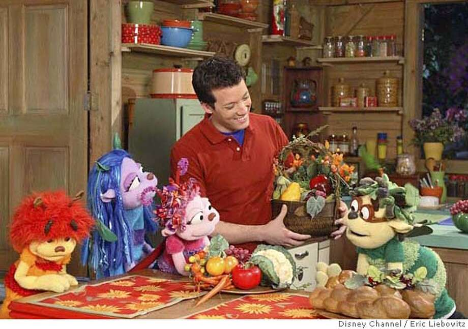 "Broadway talent heads to Disney Channel when the new live-action puppet series ""Johnny and the Sprites"" premieres Saturday, January 13 (10:00 a.m. ET/PT) during the learning-focused Playhouse Disney programming block for preschoolers From left to right: Basil, Lily, Ginger, Johnny (John Tartaglia) and Basil gather round the kitchen table (DISNEY CHANNEL/ERIC LIEBOWITZ) COMMERCIAL PHOTO Photo: ERIC LIEBOWITZ"