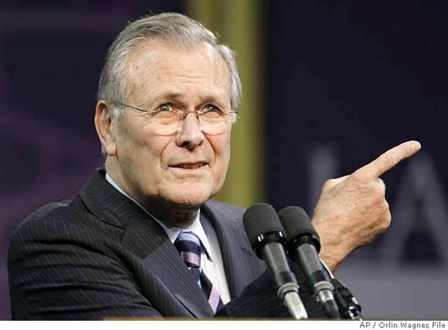 Defense Secretary Donald Rumsfeld asks for another question following his Landon Lecture at Kansas State University in Manhattan, Kan., Thursday, Nov. 9, 2006. (AP Photo/Orlin Wagner)  Ran on: 11-12-2006 Ran on: 11-14-2006  Defense Secretary Donald Rums- feld is one of several U.S. officials the group seeks to charge. Photo: ORLIN WAGNER