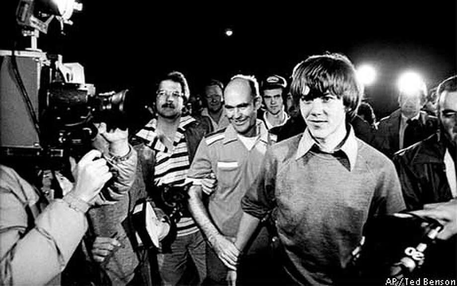 FILE--Surrounded by TV cameras, Steven Stayner, right foreground, and and his brother Delbert Stayner are shown walking toward their Merced County, Calif., home in this March 2, 1980 file photo, as Steven was reunited with his family following a 7-year kidnap ordeal. A third brother, Cary Stayner, arrested Saturday, July 24, 1999 in connection with four deaths in the Yosemite National Park area, is seen in a ball cap in the background between his brothers Steven and Delbert. (AP Photo/The Modesto Bee, Ted Benson, File) Photo: TED BENSON