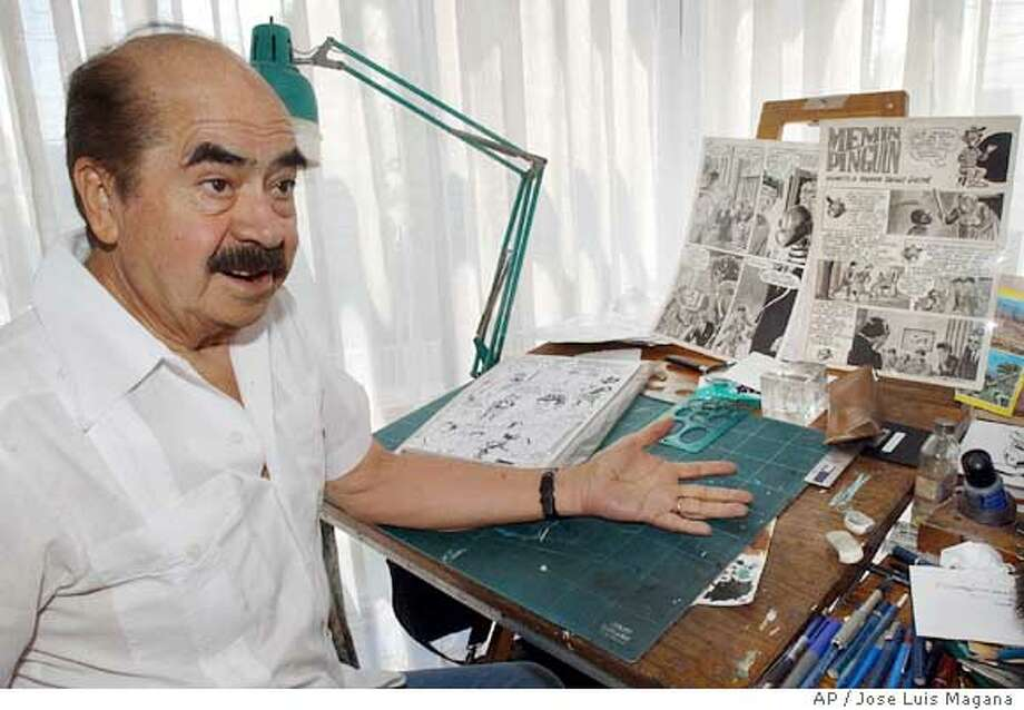 """Sixto Valencia, 71, speaks about the cartoon character Memin Pinguin, during an interview Thursday June 30, 2005, in Mexico City. The White House on Thursday objected to a Memin Pinguin postage stamp issued by the Mexican government, saying that """"racial stereotypes are offensive no matter what their origin."""" (AP Photo/Jose Luis Magana) Ran on: 07-04-2005  Sixto Valencia Burgos, above, has drawn the Mem�n Pingu�n character, below, for decades and shrugs off the current controversy. He's always drawn the character as &quo;the good guy,&quo; one who has explored U.S. racism several times in the past. Ran on: 07-04-2005 Ran on: 07-04-2005  Sixto Valencia Burgos, above, has drawn the Mem�n Pingu�n character, below, for decades and shrugs off the current controversy. He's always drawn the character as &quo;the good guy,&quo; one who has explored U.S. racism several times in the past. Photo: JOSE LUIS MAGANA"""