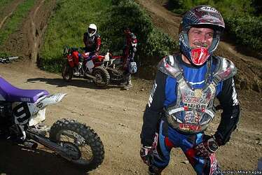 Revved up for Hill Climb / Dirt bike riders raise the dust