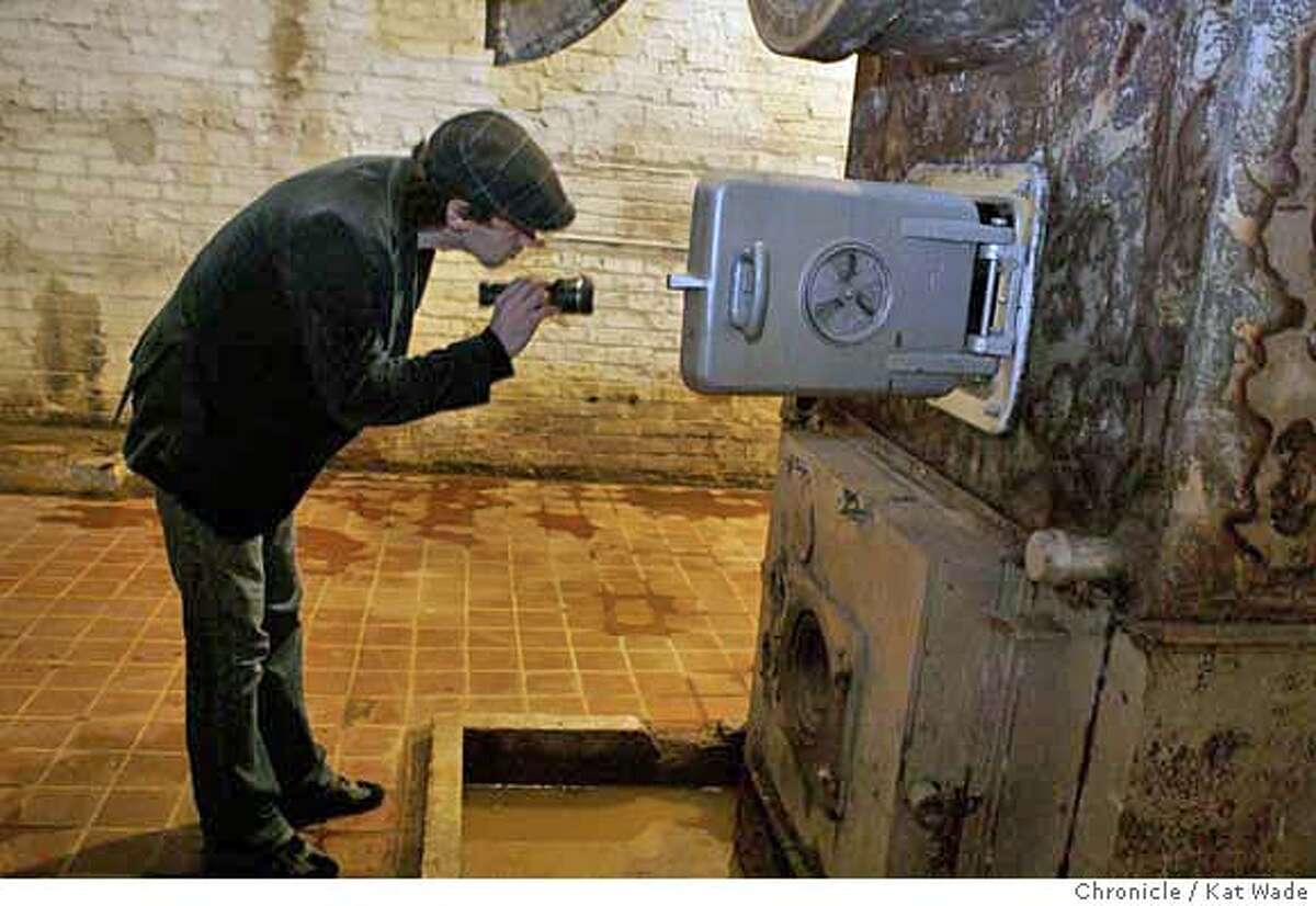 SEX_0047_KW_.jpg On Thursday January 11, 2007 ' Men in pain' webmaster and porn director James Mogul looks into the boiler when the Chronicle is given a tour of the Old National Guard Armory which has been purchased by the sex bondage website kink.com for a new location ffor their film production and website company on Thursday January 11, 2007. This is one room that needs little work to become a set for their fetish films. The new location cost 14 million dollars and has 200,000 square feet that will be transformed into sets, offices and work space. Kat Wade/The Chronicle Mandatory Credit for San Francisco Chronicle and photographer, Kat Wade, Mags out