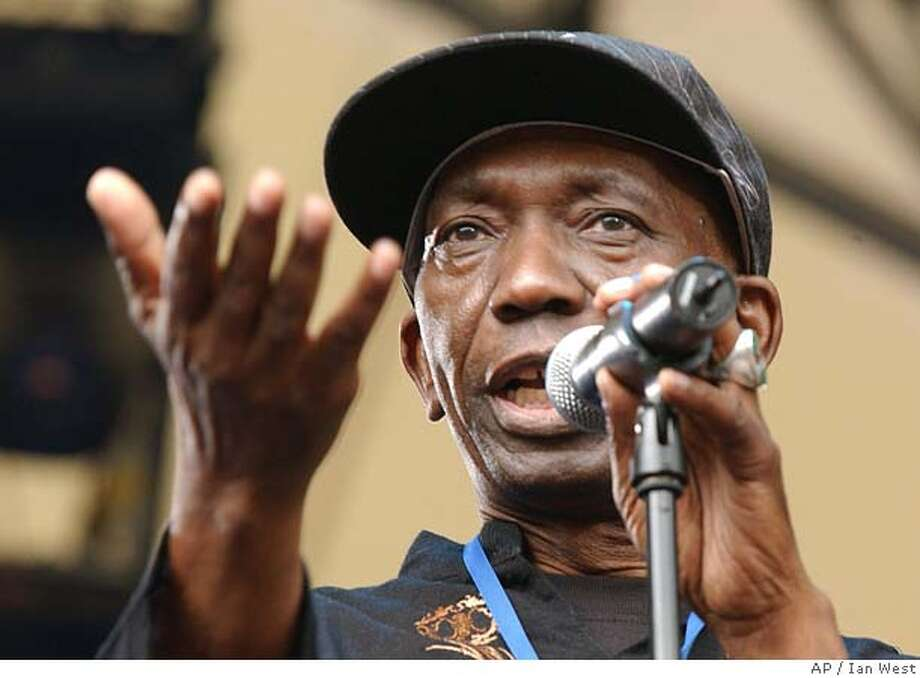 "Thomas Mapfumo, from Zimbabwe, is seen performing at the Live8 Africa Calling concert, today Saturday 2 July 2005, at the Eden Project in Cornwall, southwestern England. Senegalese superstar Youssou N'Dour was headlining the bill, which featured more than 18 acts from 14 countries, including Beninoise diva Angelique Kidjo, a three-time Grammy nominee. The ""Africa Calling"" concert near the Eden Project and the Live 8 concert in Johannesburg, South Africa, were organized after criticism that African artists had been largely excluded from the global music marathon aimed at raising awareness of Africa's poverty. (AP Photo/Ian West, PA) ** UNITED KINGDOM OUT ** Photo: IAN WEST"