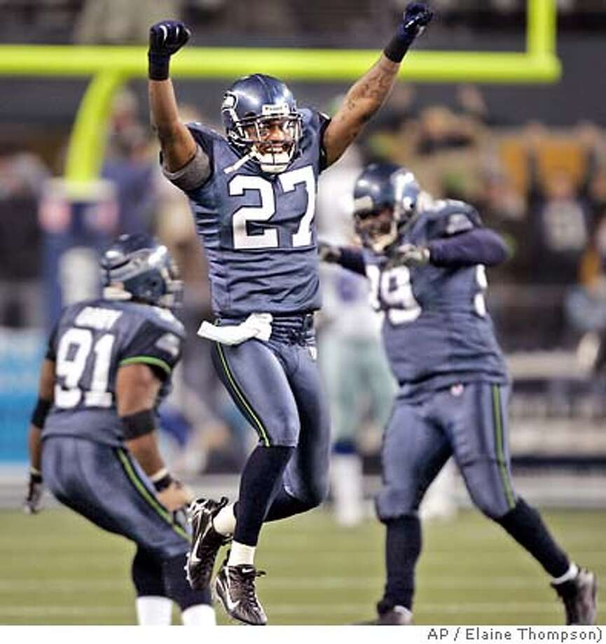 Seattle Seahawks' Jordan Babineaux (27) reacts as teammates Chuck Darby, left, and Rocky Bernard celebrate behind as they beat the Dallas Cowboys in an NFC wild card playoff football game Saturday, Jan. 6, 2007, in Seattle. The Seahawks won, 21-20. (AP Photo/Elaine Thompson) Photo: Elaine Thompson