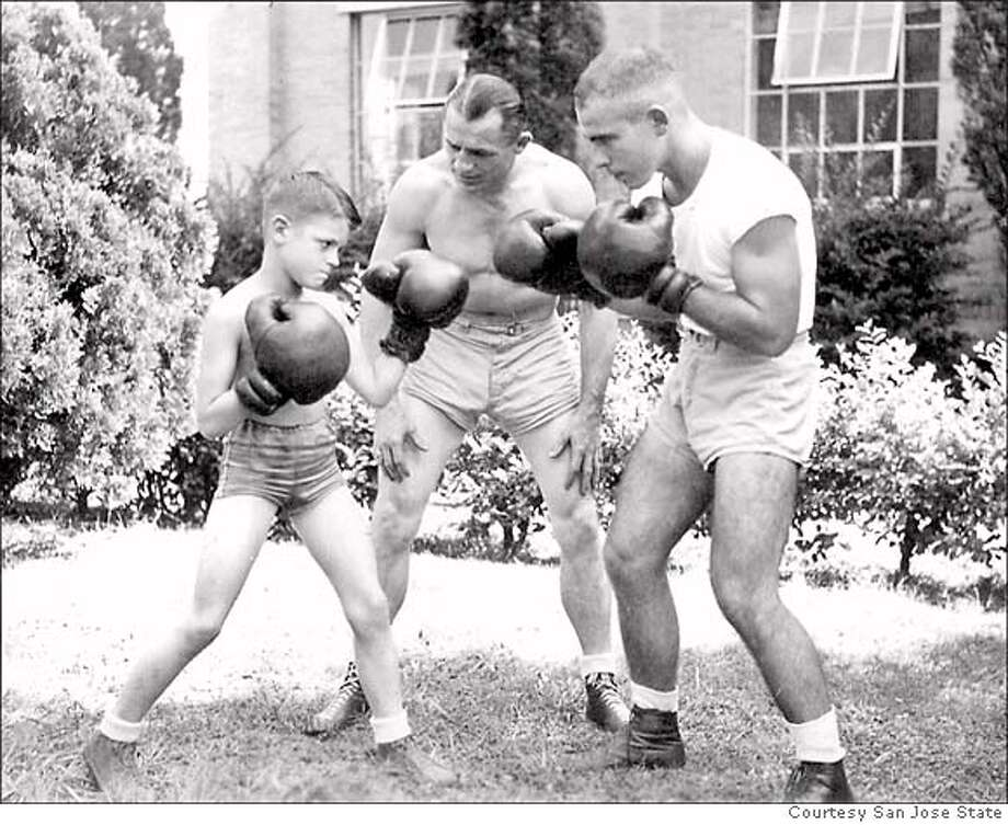San Jose State boxing team, 1946 or 47. From left, Ron Portal, his father and the team's coach DeWitt Portal, assistant coach Julius Menendez.  Credit: Courtesy San Jose State Photo: Courtesy San Jose State