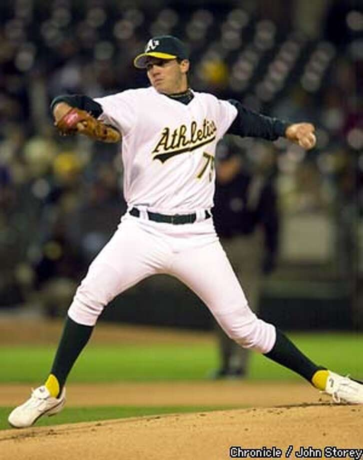 ATHLETICS-C-02APR03-SP-JRS-The A's vs the Seattle Mariners at the Network Coliseum. Barry Zioto of the A's pitches against the Mariners. Chronicle photo by John Storey. Photo: John Storey