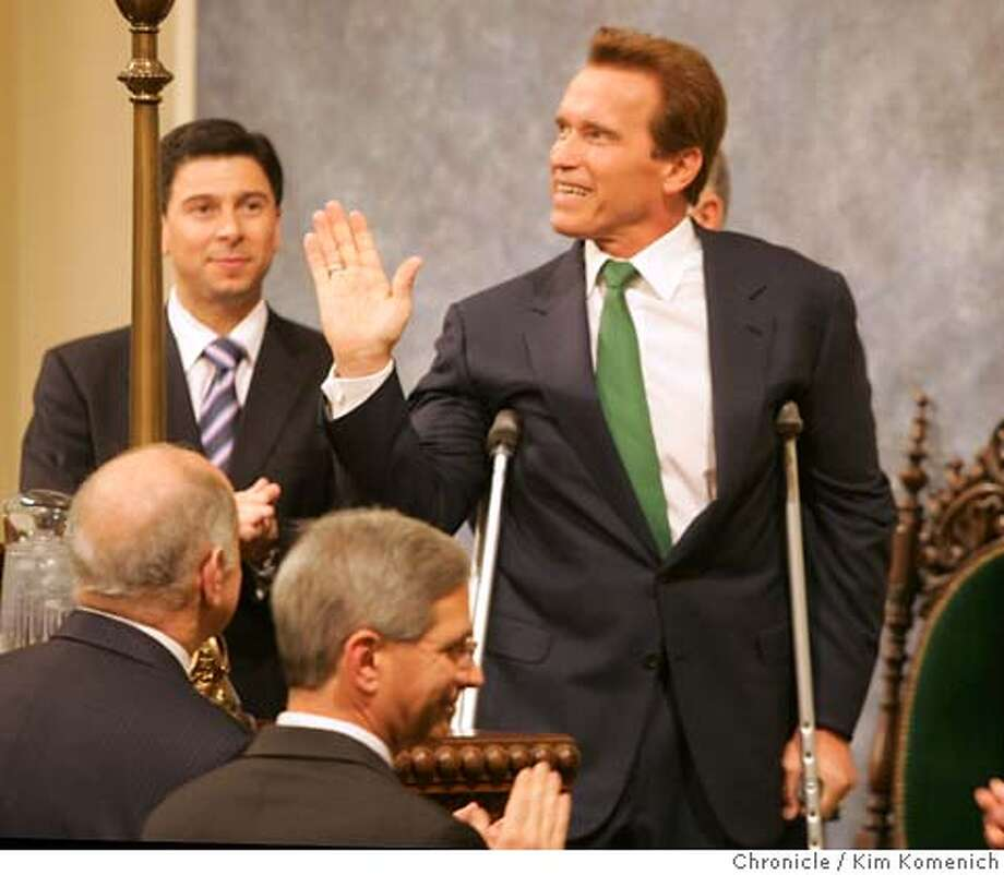 California Gov. Arnold Schwarzenegger uses crutches to get the to the podium of the California Assembly Chambers where he gives the 2007 State of the State Address.  Photo by Kim Komenich/The Chronicle Photo: Kim Komenich