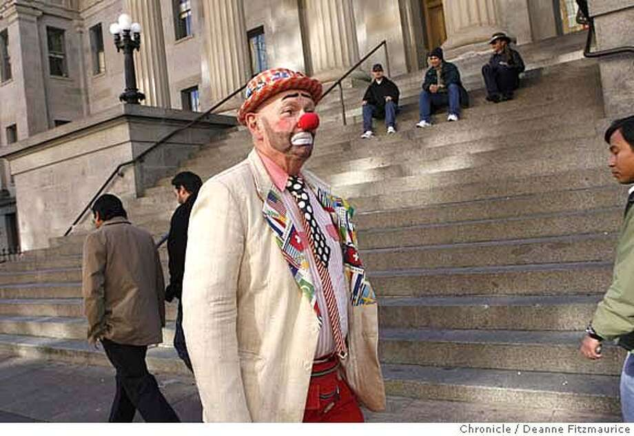 weather_0311_df.jpg  A clown, Larry Welton, who goes by Sylvester the Clown, walks to work, in downtown San Francisco where he will blow up balloons. he said that cold weather does not affect business but wind and rain cause business to be slow.  Photographed in San Francisco on 1/11/07. Photo / Deanne Fitzmaurice Mandatory credit for photographer and San Francisco Chronicle. /Magazines out. Photo: Deanne Fitzmaurice