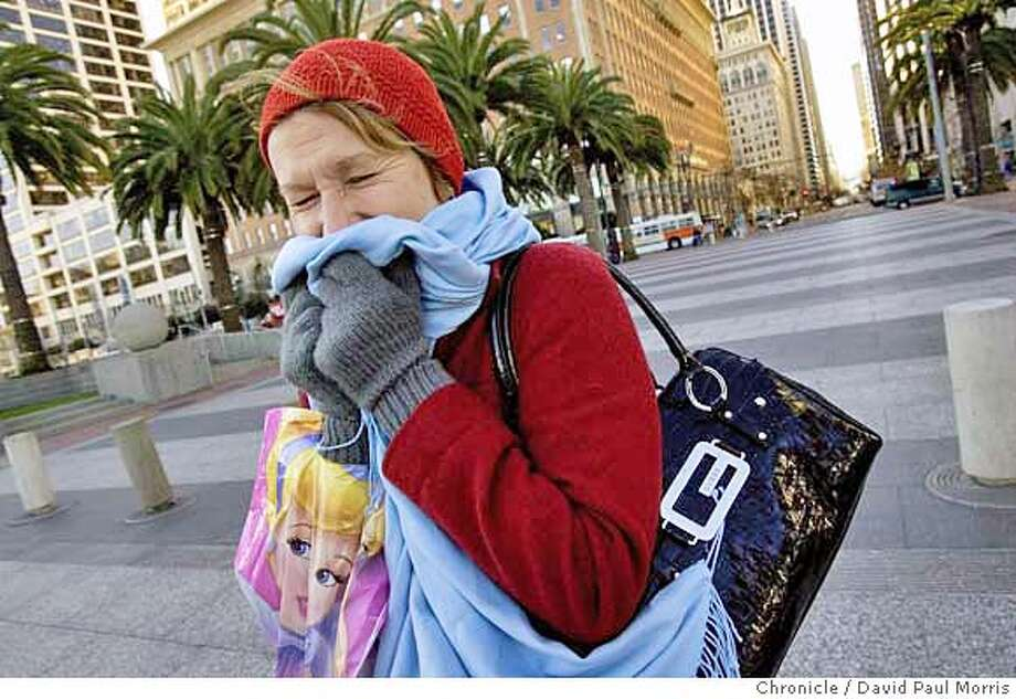 SAN FRANCISCO - JANUARY 12: Cindy Kamikawa from Hawaii tries to stay warm as she crosses the Embarcadero on January 12, 2007 in San Francisco, California. The cold weather is expected to continue through the weekend in and around the bay area. (Photo by David Paul Morris/The Chronicle) Photo: David Paul Morris