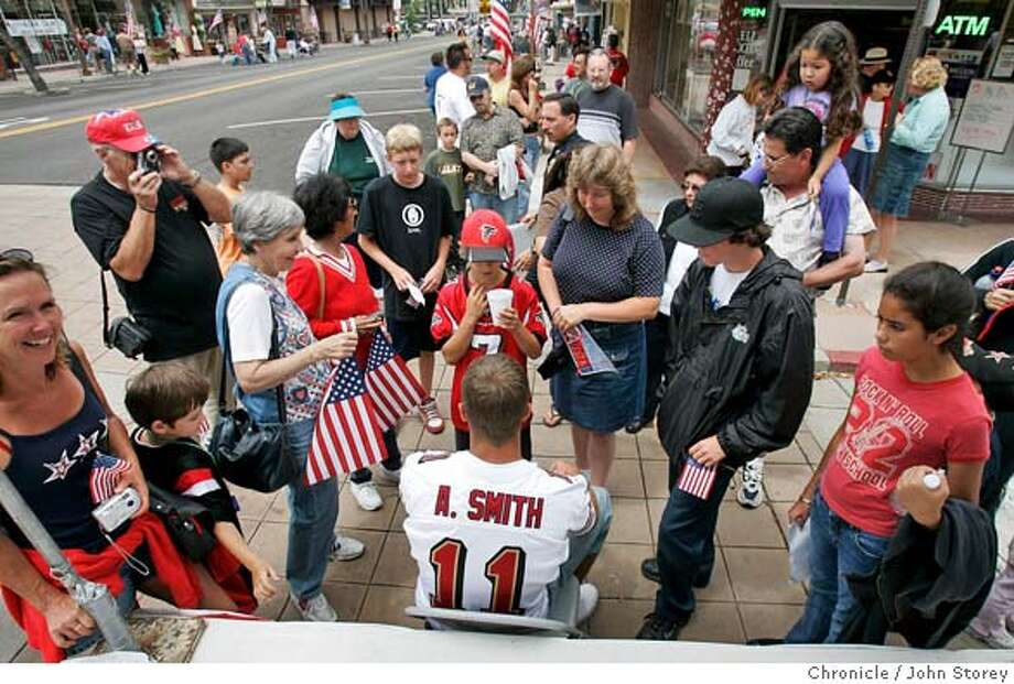 49Smith_jrs_0176.jpg  Alex signs autographs for fans during a Flag Day parade in downtown La Mesa. Story about the San Francisco 49ers new quarterback, Alex Smith, in his home town of La Mesa.  John Storey La Mesa Event on 6/4/05 MANDATORY CREDIT FOR PHOTOG AND SF CHRONICLE/ -MAGS OUT Photo: John Storey