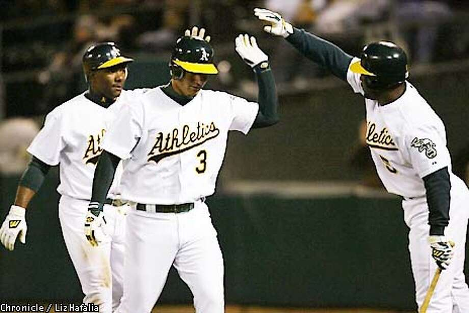 ATHLETICS vs. ANGELS at Oakland Coliseum--Eric Chavez and Miguel Tejada make two runs in the first inning. (PHOTOGRAPHED BY LIZ HAFALIA/THE SAN FRANCISCO CHRONICLE) Photo: LIZ HAFALIA