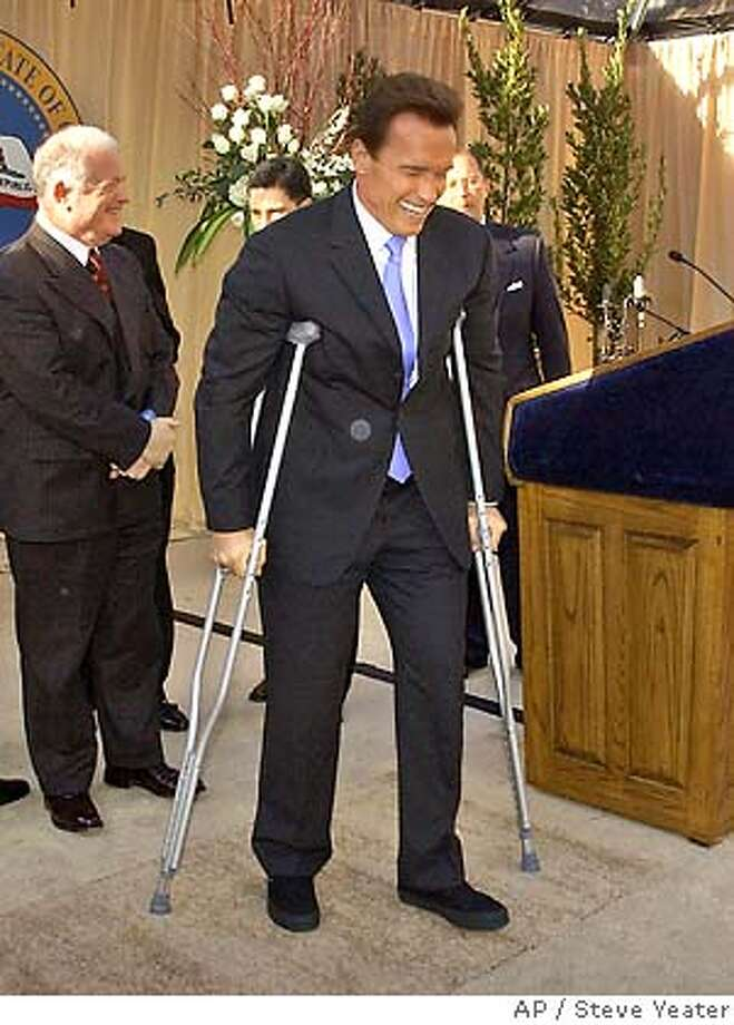 �Gov. Arnold Schwarzenegger's uses crutches to walk to his table after speaking at a a luncheon following his second inauguration in Sacramento, Calif., Friday, Jan. 5, 2006.(AP Photo/Steve Yeater,Pool) Photo: Steve Yeater