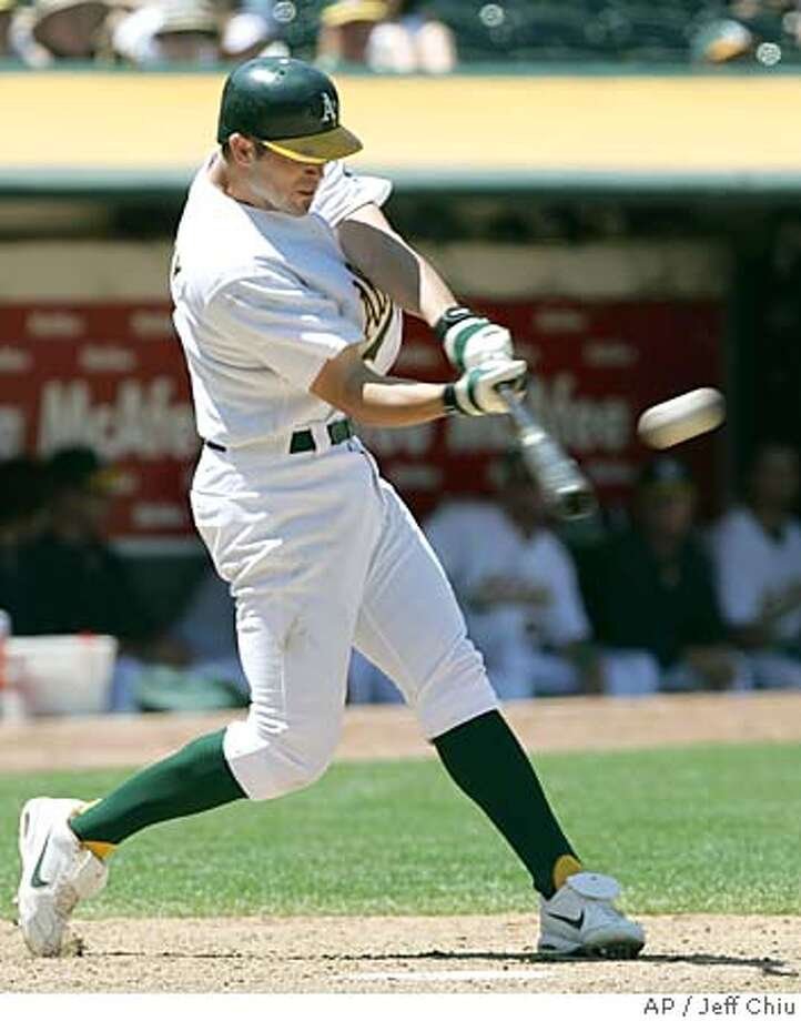 Oakland Athletics' Bobby Crosby connects for his two-run home run off of Seattle Mariners' Matt Thornton in the seventh inning in Oakland, Calif., on Thursday, June 30, 2005. The Athletics won 6-2. (AP Photo/Jeff Chiu) Photo: JEFF CHIU