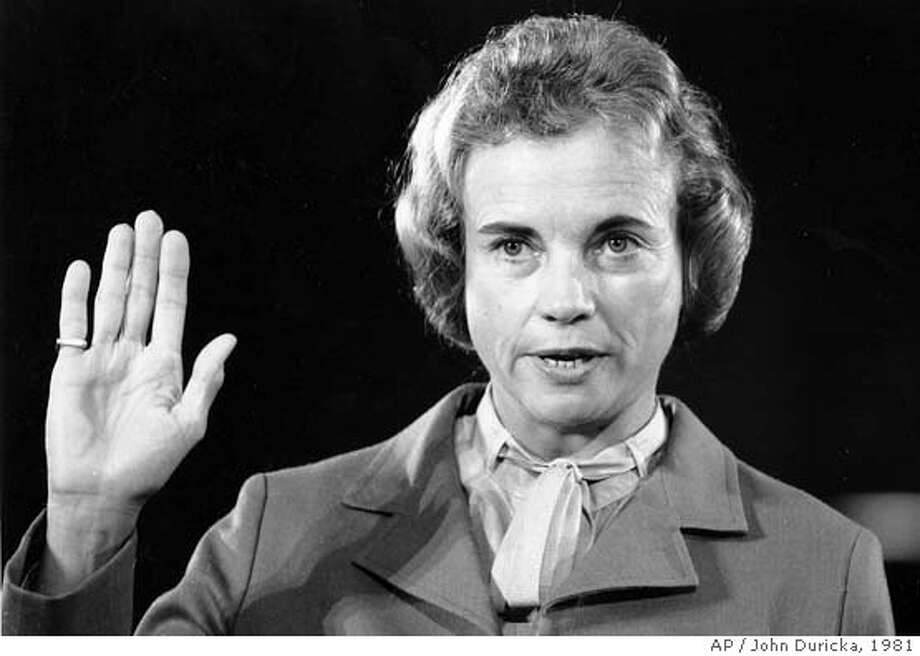 ** FILE ** Supreme Court nominee Sandra Day O'Connor raises her right hand to be sworn in before the Senate Judiciary Committee on Capitol Hill in Washington, D.C. on Sept. 9, 1981. O'Connor, the first woman appointed to the Supreme Court and a key swing vote on issues such as abortion and the death penalty, said Friday July 1, 2005 she is retiring. (AP Photo/John Duricka) Ran on: 07-02-2005  Sandra Day O'Connor, left, prepares to testify before the Senate Judiciary Committee in 1981. Her nomination was con- firmed by the full Senate 99-0. Photo: JOHN DURICKA