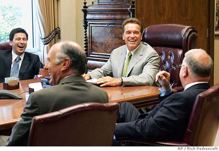 Assembly Speaker Fabian Nunez, D-Los Angeles, left, state Senate Minority Leader Dick Ackerman, R-Fullerton, second from left and California Gov. Arnold Schwarzenegger, second from right, laugh at a comment made by state Senate President Pro Tem Don Perata, D-Oakland, right, before their meeting held to work on the state budget, at the Governor's Capitol office in Sacramento, Calif., Thursday, June 30, 2005. (AP Photo/Rich Pedroncelli) Photo: RICH PEDRONCELLI