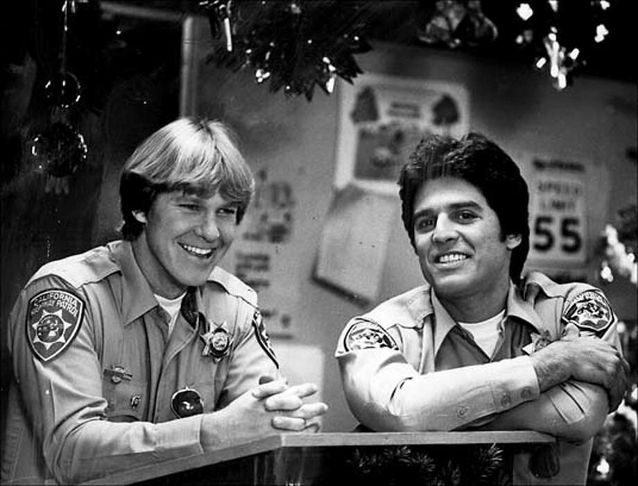 """�The yule spirit gets to Officers Baker (Larry Wilcox, right) and Poncherello (Erik Estrada) in the """"Christmas Watch"""" episode of NBC-TV's """"CHiPs"""" Photo: Handout"""