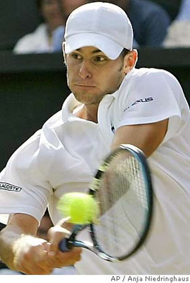 Andy Roddick, of the USA, returns to Sebastien Grosjean, of France, during their quarterfinal match on Centre Court at Wimbledon Wednesday, June 29, 2005. (AP Photo/Anja Niedringhaus) Photo: ANJA NIEDRINGHAUS