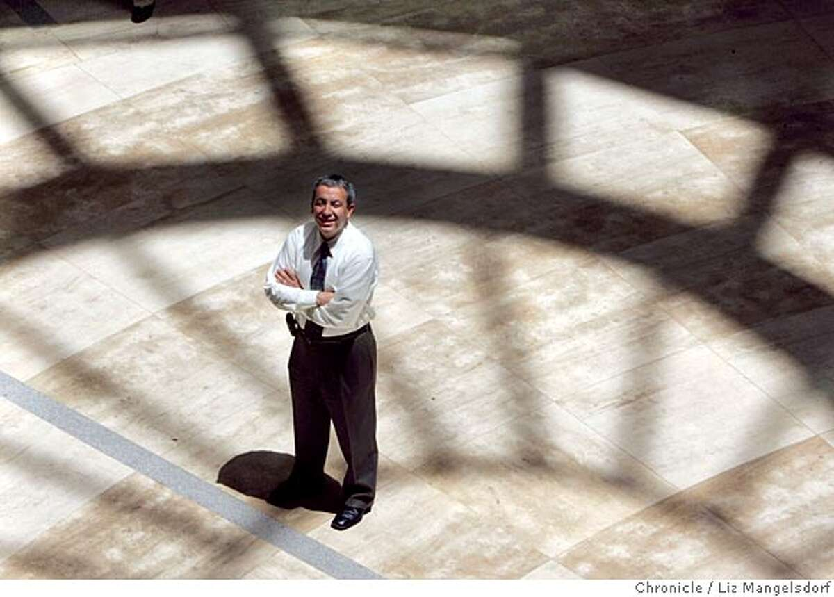 Event on 6/22/05 in San Francisco. The new San Francisco city librartian, Luis Herrera in the entry way at the main library, with the shadow of the dome shining down on him. Liz Mangelsdorf / The Chronicle