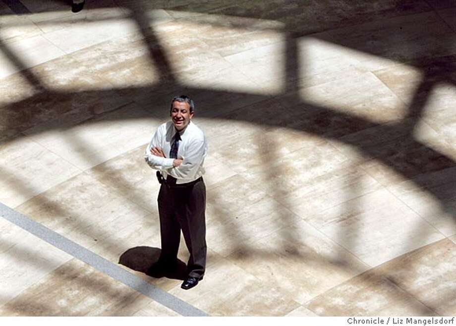 Event on 6/22/05 in San Francisco.  The new San Francisco city librartian, Luis Herrera in the entry way at the main library, with the shadow of the dome shining down on him.  Liz Mangelsdorf / The Chronicle Photo: Liz Mangelsdorf