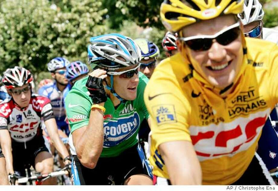 Six-time Tour de France winner and leader of the Discovery Channel cycling team, Lance Armstrong of Austin, Texas, wearing the best sprinter's green jersey, rear center, and overall leader David Zabriskie of the U.S., of Team CSC, right, ride through the town of Challans in the first kilometers of the second stage of the Tour de France cycling race, between Challans and Les Essarts, western France, Sunday, July 3, 2005. (AP Photo/Christophe Ena) Ran on: 07-04-2005  Belgium's Tom Boonen leads the pack, sprinting to the finish to win Sunday's second stage at Les Essarts, France. Photo: CHRISTOPHE ENA