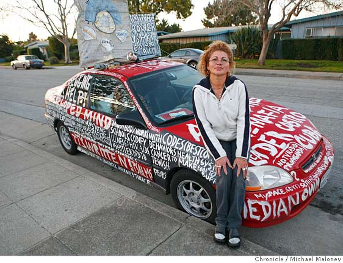 Estrella Benavides and her red Honda. Estrella Benavides of San Mateo is in trouble with the city of San Mateo for painting religious slogans all over her house and car. Benavidas of 1864 Cottage Avenue is violating the city's municipal code. Photo taken on 1/8/07 by Michael Maloney / San Francisco Chronicle
