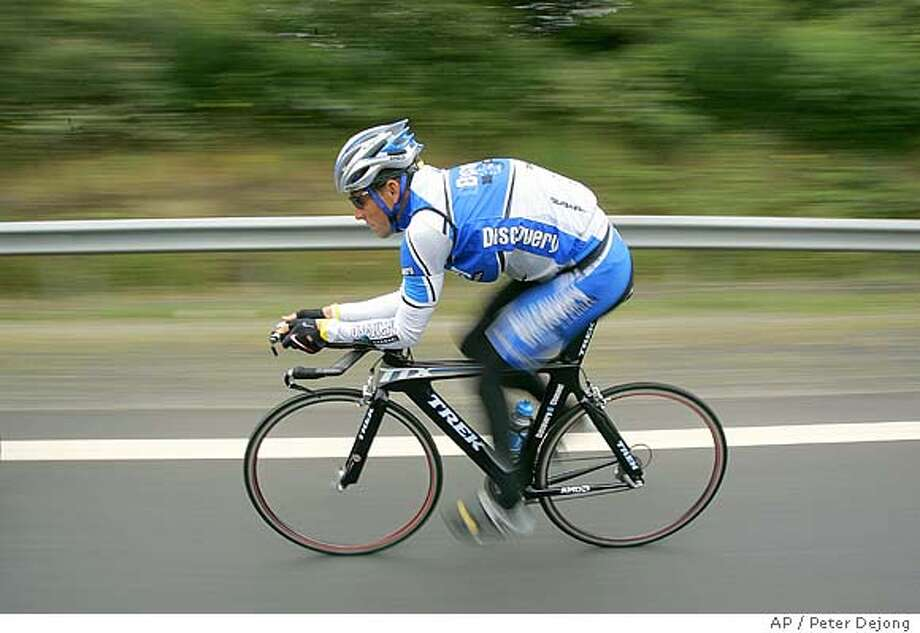 Six-time Tour de France winner, Lance Armstrong, of Austin, Texas, trains outside La Chapelle-sur-Erdre, near Nantes, western France, Friday, July 1, 2005, ahead of the 92nd Tour de France cycling race. The race starts Saturday with a 19-kilometer (11.80-mile) individual time trial between the western town of Fromentine and the island of Noirmoutier. (AP Photo/Peter Dejong) Photo: PETER DEJONG