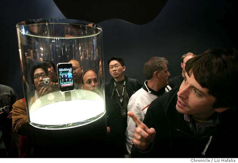 APPLE10_324_LH.JPG IPhone is introduced at Macworld in Moscone Center today. Tyler Fazakerley at far right.  cq--Tyler Fazakerley  Photographed by Liz Hafalia  Ran on: 01-10-2007  Apple's new $499 iPhone, in a display case that looks worthy of the Hope Diamond, is admired by Tyler Fazakerley (far right) and others at the Macworld Expo.  Ran on: 01-10-2007  Apple's new $499 iPhone, in a display case that looks worthy of the Hope Diamond, is admired by Tyler Fazakerley (far right) and others at the Macworld Expo. Photo: Liz Hafalia