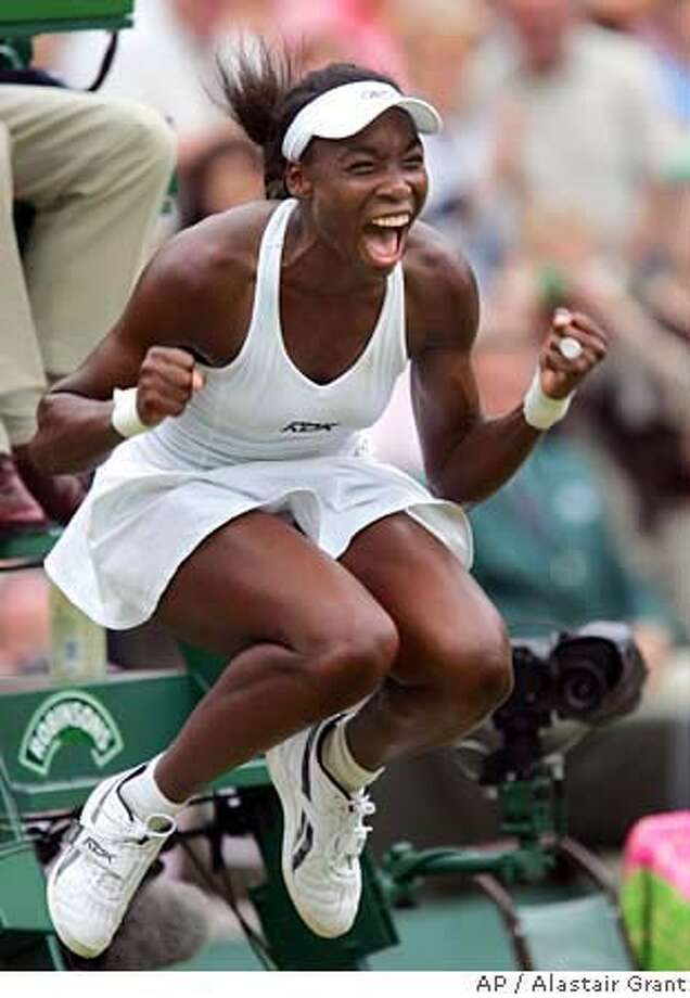 Venus Williams, of the USA, celebrates winning the Ladies' Singles final at Wimbledon Saturday, July 2, 2005. Williams beat Lindsay Davenport, of the USA, 4-6, 7-6 (4), 9-7 (AP Photo/Alastair Grant) Photo: ALASTAIR GRANT