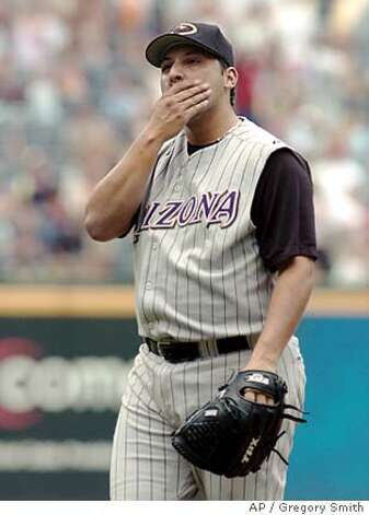 Arizona Diamondbacks starter Russ Ortiz covers his mouth after giving up a three-run home run to Atlanta Braves' Julio Franco during the third inning Saturday, Aug. 13, 2005, in Atlanta. The Braves won 9-5. (AP Photo/Gregory Smith) Ran on: 08-14-2005  Russ Ortiz seems a bit surprised after giving up a three-run home run to 46-year-old Julio Franco.  Ran on: 01-10-2007  Russ Ortiz will compete for the fifth spot in the Giants' rotation. Photo: GREGORY SMITH