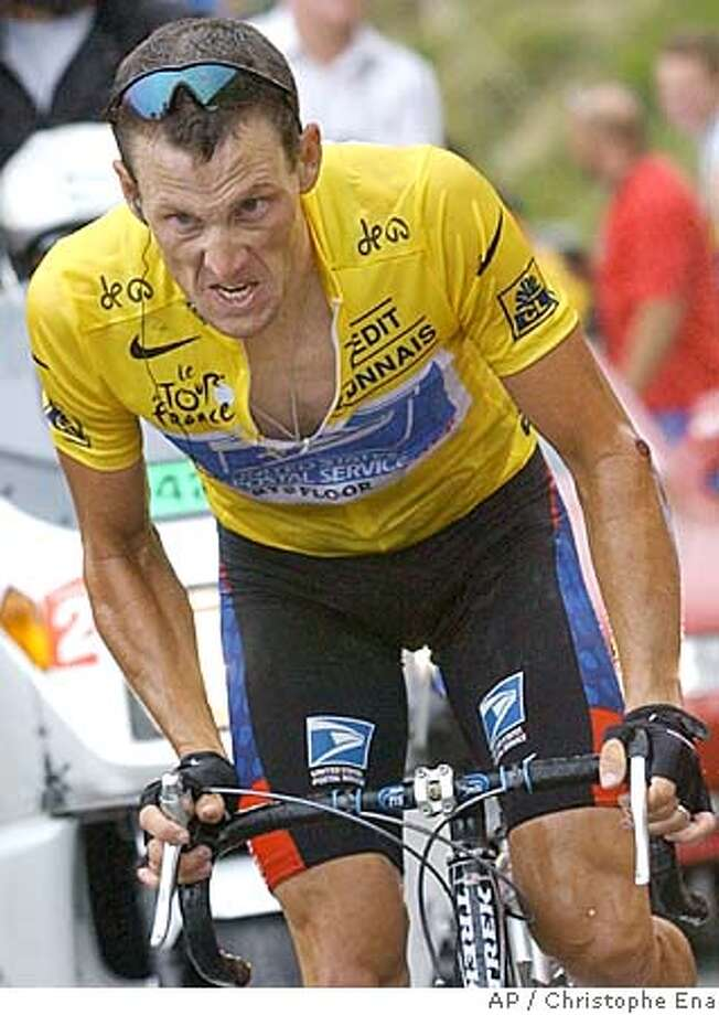 Overall leader Lance Armstrong, of Austin, Texas, strains in the final ascent towards Luz-Ardiden, during the 15th stage of the Tour de France cycling race between Bagneres-de-Bigorre and Luz-Ardiden, French Pyrenees, Monday, July 21, 2003. Armstrong won the stage. (AP Photo/Christophe Ena) Ran on: 07-02-2005  Photo caption Photo: CHRISTOPHE ENA