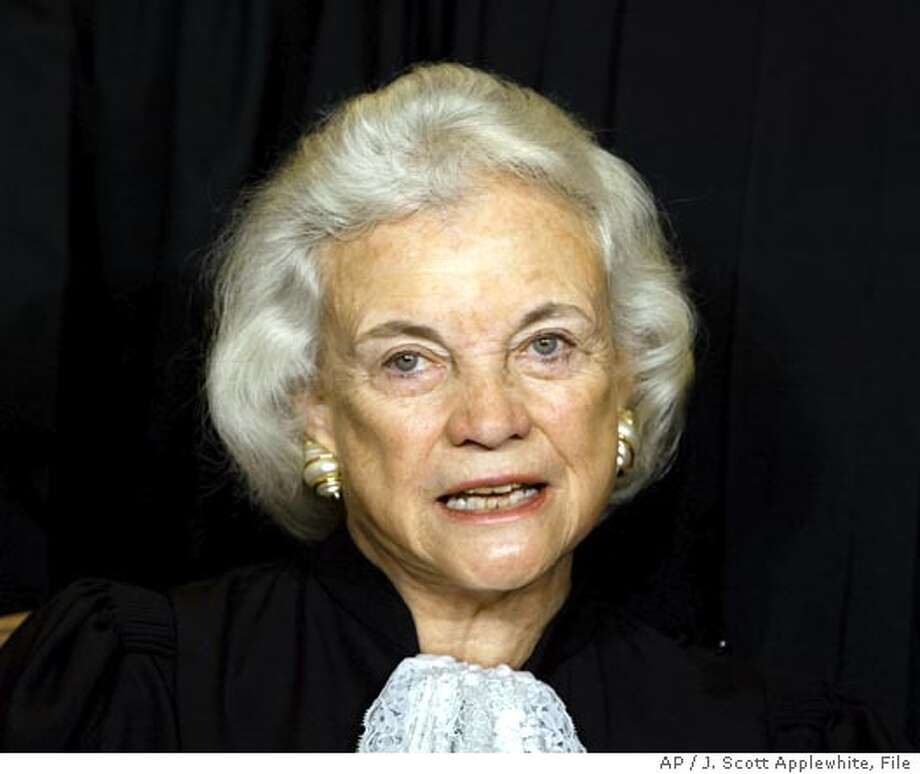 Supreme Court Associate Justice Sandra Day O'Connor poses for photos during a group portrait session with the members of the U.S. Supreme Court, at the Supreme Court Building in Washington, Friday, Dec. 05, 2003. O'Connor made history as the first woman on the high court when President Reagan nominated her, taking her seat Sept. 25, 1981. (AP Photo/J. Scott Applewhite) Photo: J. SCOTT APPLEWHITE