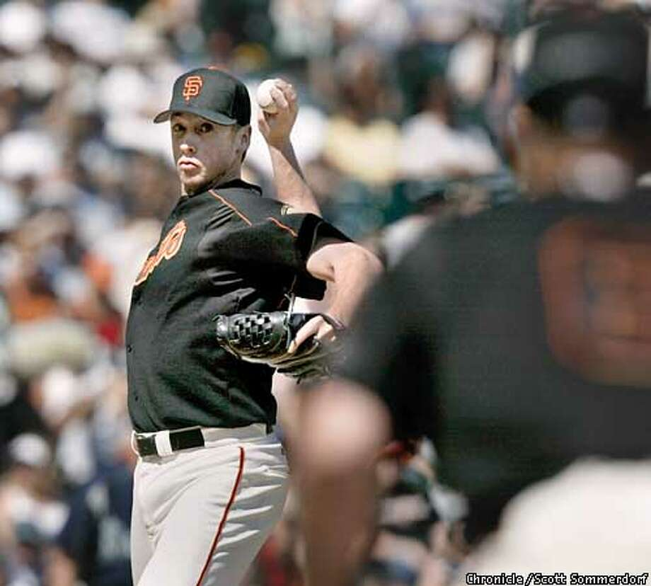 Young starting pitcher Jesse Foppert threw a nice game, and might have won himself a spot in the Giants lineup even though he took the loss in the Giant's 3-1 loss to Seattle Sunday, March 30th, 2003. Here, Foppert throws to first base to make stolen base threat Mike Cameron lessen his lead off first. SF CHRONICLE PHOTO BY SCOTT SOMMERDORF Photo: Scs