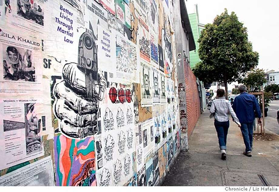 RAHIMI03_003_LH.JPG There is a dispute over the wall of the former Mission police station now covered with protest posters. Photographed by Liz Hafalia on 6/27/05 in San Francisco, CA Creditted to the San Francisco Chronicle/Liz Hafalia Photo: Liz Hafalia