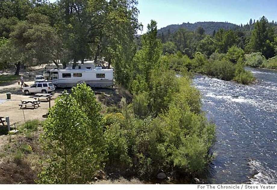 RV's are backed into their camp site spaces on the American River at Coloma Resort in Coloma, Calif., on Monday, June 27, 2005. Photo by Steve Yeater/For The Chronicle Photo: Steve Yeater/For The Chronicle