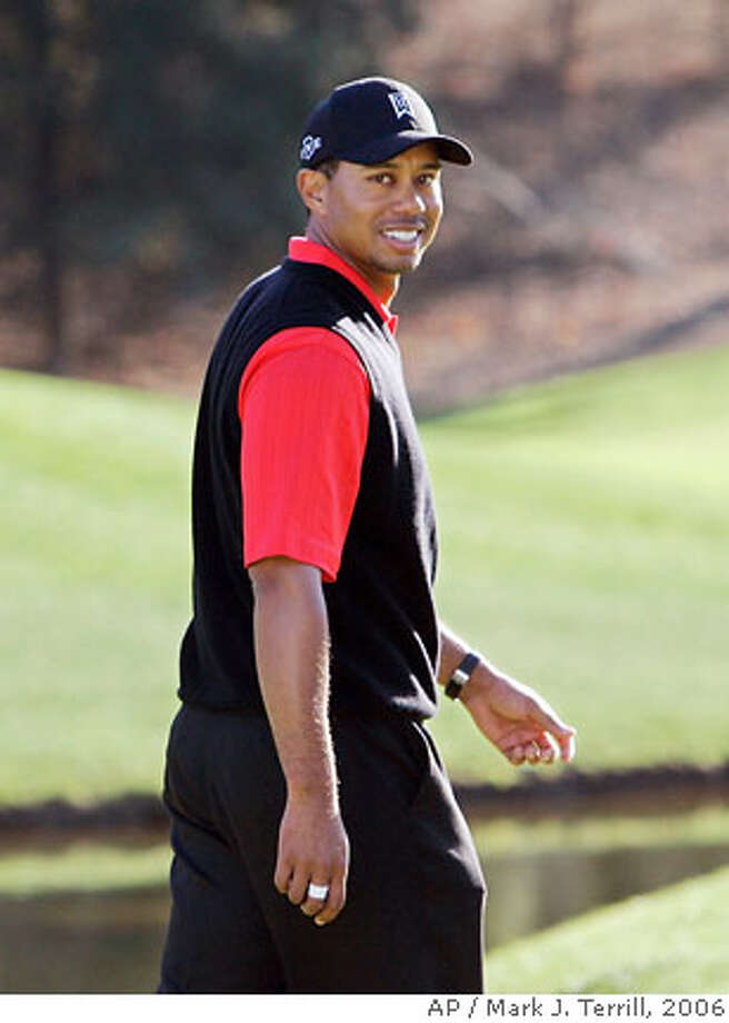 Tiger Woods looks over his shoulder after winning the Target World Challenge gold tournament, Sunday, Dec. 17, 2006, in Thousand Oaks, Calif. (AP Photo/Mark J. Terrill) Photo: Mark J. Terrill
