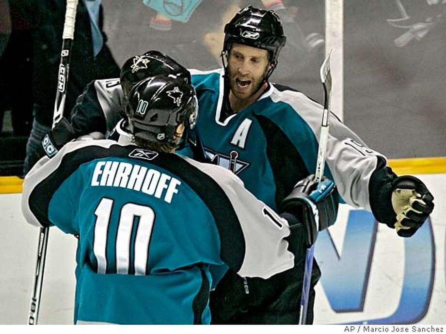 San Jose Sharks' Joe Thornton, left, is hugged by teammate Christian Ehrhoff (10) of Germany after Thornton's goal in the third period of a NHL hockey game in San Jose, Calif., Saturday, Nov. 25, 2006.(AP Photo/Marcio Jose Sanchez)  Ran on: 12-02-2006  Joe Thornton  Ran on: 12-02-2006  Joe Thornton Photo: MARCIO JOSE SANCHEZ