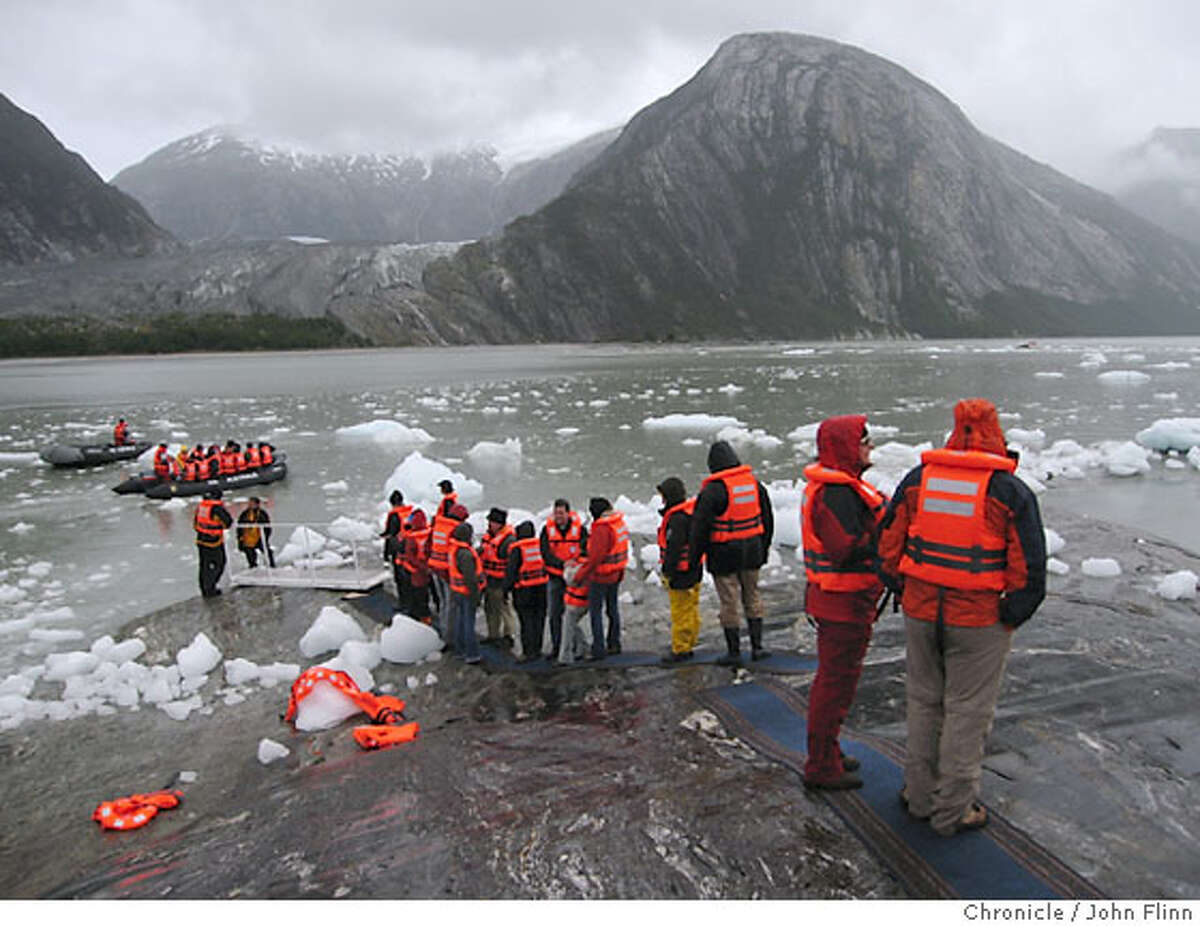 TRAVEL AUSTRALIS -- Passengers from the Via Australis line up for a Zodiac ride back to the ship.