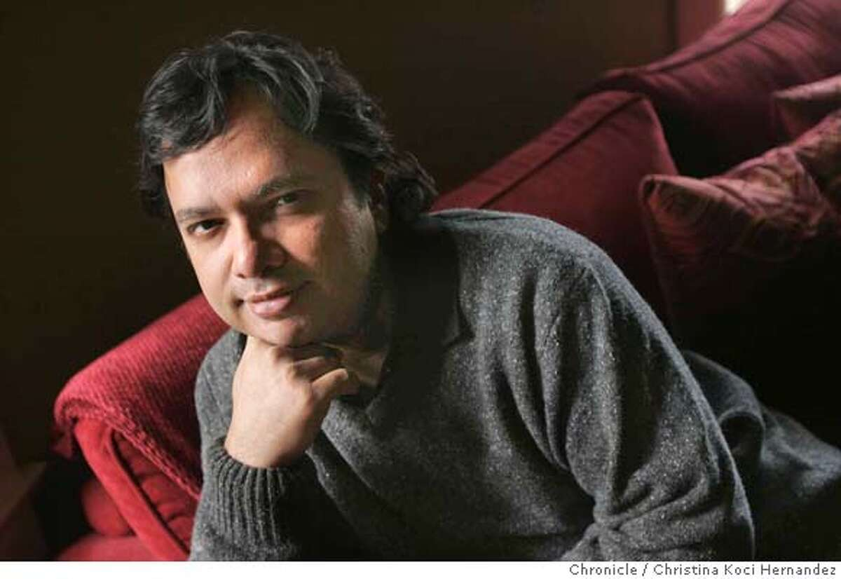 Portrait of author Vikram Chandra , at his Oakland home. Ganesh Gaitonde, the main character of Vikram Chandra�s sprawling and sensational new novel, SACRED GAMES, has been called �the most compelling character in crime fiction since Don Corleone� (Publishers Weekly). The book is a bestseller in India and HarperCollins is giving it a massive marketing push for its Jan. 9 pub date. We talk to Chandra in Berkeley (where he lives more than half the year and teaches at Cal) about creating an epic 19th-century style novel that brings to life the complex textures of daily life in modern India.(CHRSTINA KOCI HERNANDEZ/CHRONICLE) Ran on: 01-08-2007 Sacred Games was hyped as an Indian version of The Godfather.