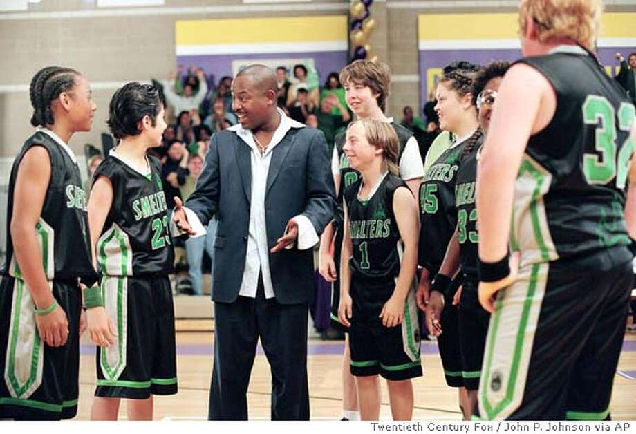 "In this photo provided by Twentieth Century Fox, Coach Roy McCormick (Martin Lawrence) gives a pep talk to the Smelters, from left: Keith Ellis (Oren Williams), One Love (Eddy Martin), Ralph (Steven Anthony Lawrence), Wes (Steven Christopher Parker), Big Mac (Tara Correa), Goggles (Gus Hoffman) and Fuzzy (Logan McElroy). in ""Rebound."" (AP Photo/Twentieth Century Fox/John P. Johnson) Photo: JOHN P. JOHNSON"