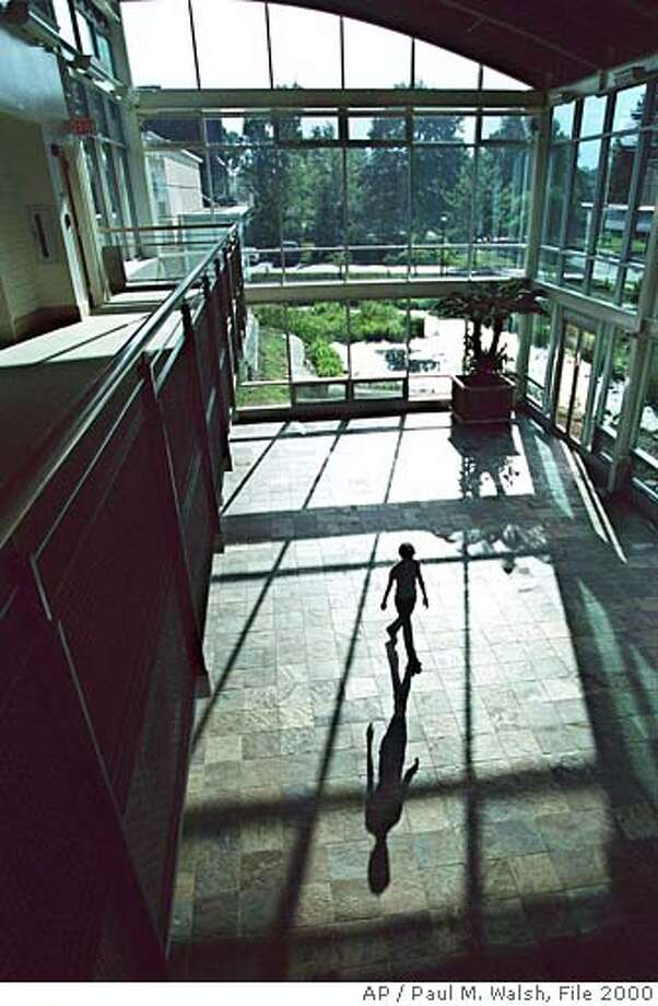 Oberlin College student, Paige Wiegman, 22, of Pittsburgh, Pa., walks through the atrium of the new Adam Joseph Center for Environment Studies building, at Oberlin College, in Oberlin, Ohio, Saturday, Sept. 9, 2000. The building has many self-sufficient features such as solar panels, indoor wastewater treatment to name a few. The building will be dedicated Sept. 15, 2000, and was designed by William McDonough Architects of Charlottesville, VA. (AP Photo/The Morning Journal, Paul M. Walsh)  Ran on: 01-06-2007  Oberlin College's Adam Joseph Center for Environment Studies in Ohio is among the facilities designed by the William McDonough firm, which also will do preliminary designs for Google. Photo: PAUL M. WALSH