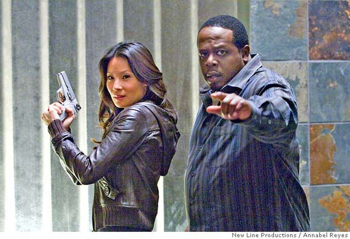 Lucy Liu (left) stars as 'Gina' and Cedric the Entertainer (right) stars as 'Jake' in New Line Cinema's upcoming comedy, Code Name: The Cleaner. Photo: �2005 Annabel Reyes/New Line Productions