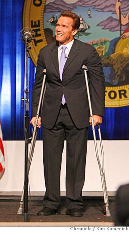 Arriving on crutches, California Governor Arnold Schwarzenegger is inaugurated at Sacramento Memorial Auditorium.  Photo by Kim Komenich/The Chronicle Photo: Kim Komenich