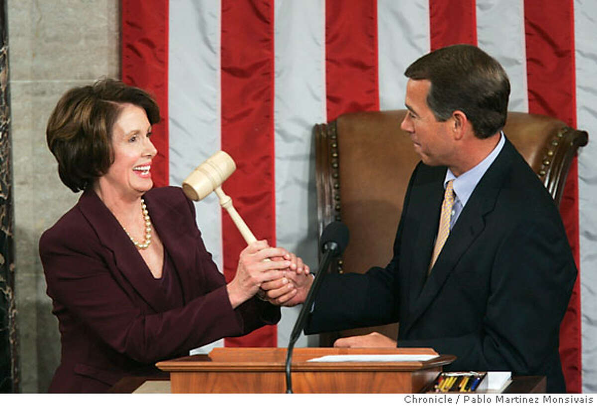 House Minority Leader John Boehner, right, hands the gavel to newly elected Speak of the House Nancy Pelosi in the House Chamber of the U.S. Capitol in Washington Thursday, Jan. 4, 2007. (AP Photo/Pablo Martinez Monsivais)