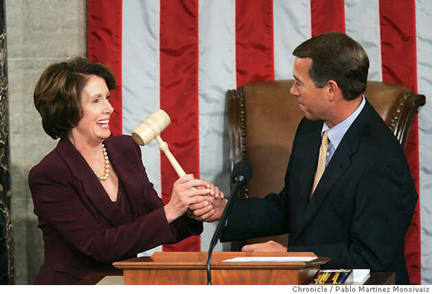 House Minority Leader John Boehner, right, hands the gavel to newly elected Speak of the House Nancy Pelosi in the House Chamber of the U.S. Capitol in Washington Thursday, Jan. 4, 2007. (AP Photo/Pablo Martinez Monsivais) Photo: PABLO MARTINEZ MONSIVAIS